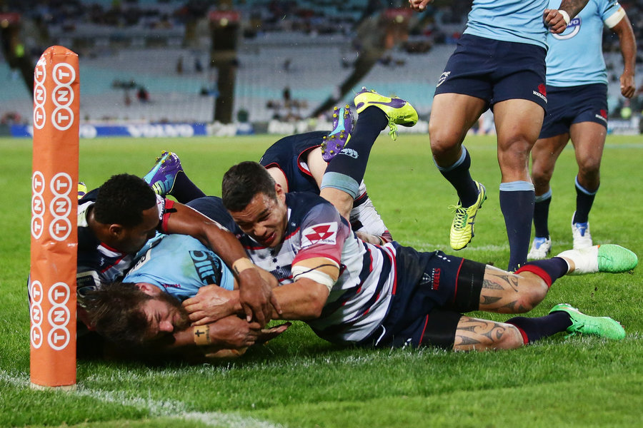 Rob Horne of the Waratahs beats the defence to score a try