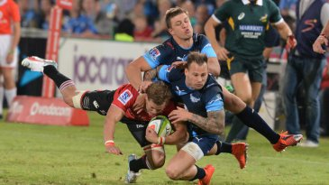 Andries Coetzee of the Lions tackled by Handre Pollard and Francois Hougaard of the Bulls, Bulls v Lions, Super Rugby, Loftus Versfeld, Pretoria, May 2, 2015