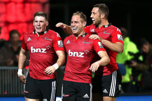 The Crusaders' Colin Slade (L), Andy Ellis (C) and Tom Taylor celebrate a try, Crusaders v Reds, Christchurch, May 8, 2015