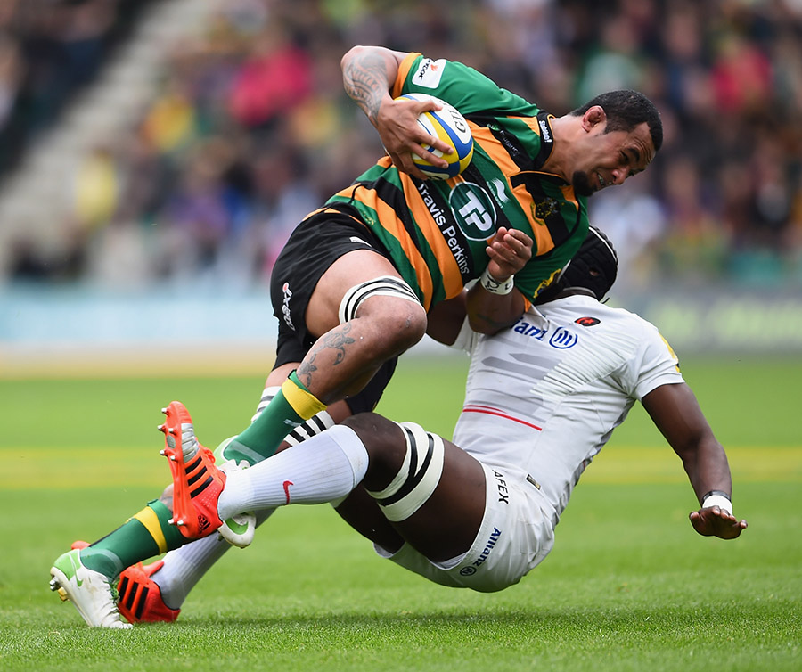 Samu Manoa of Northampton Saints is tackled by Maro Itoje of Saracens
