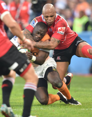 Raymond Rhule of the Cheetahs is taken high by the Lions defence, Cheetahs v Lions, Free State Stadium, Bloemfontein, May 23, 2015