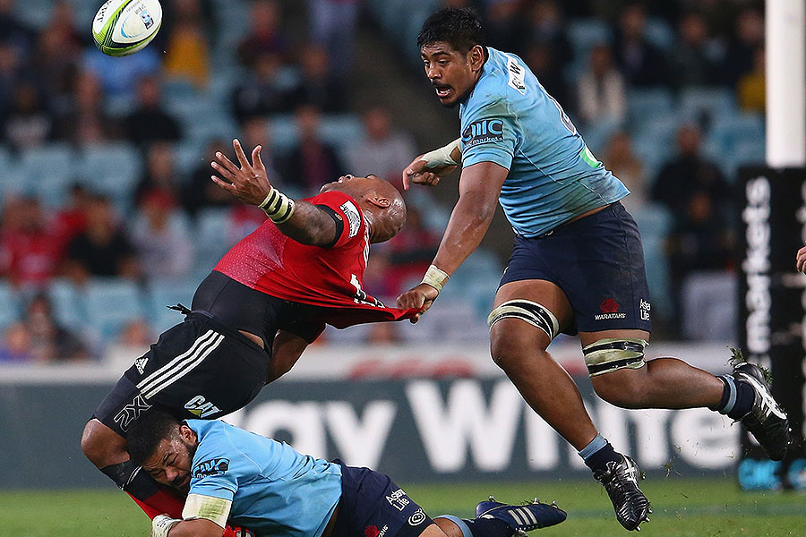 The Waratahs' Tolu Latu (B) and Will Skelton (R) tackle Nemani Nadolo