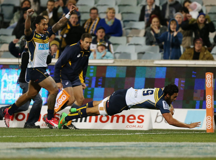 Brumbies' Jordan Smiler dives over the whitewash for his first Super Rugby try