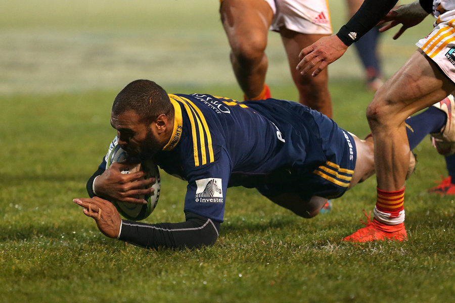 Highlanders' Patrick Osborne dives over whitewash for the opening try