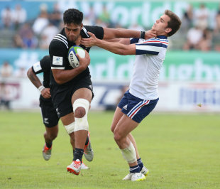 Akira Ioane of New Zealand holds off Damian Penaud to score a try, New Zealand v France, Semi-Final, World Rugby U20 Championship, Italy, June 15, 2015