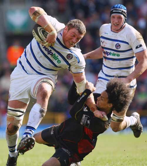 Bath's Peter Short crashes through the tackle of Richard Haughton