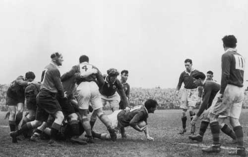 Ireland's JC Daly crawls from a ruck with the ball