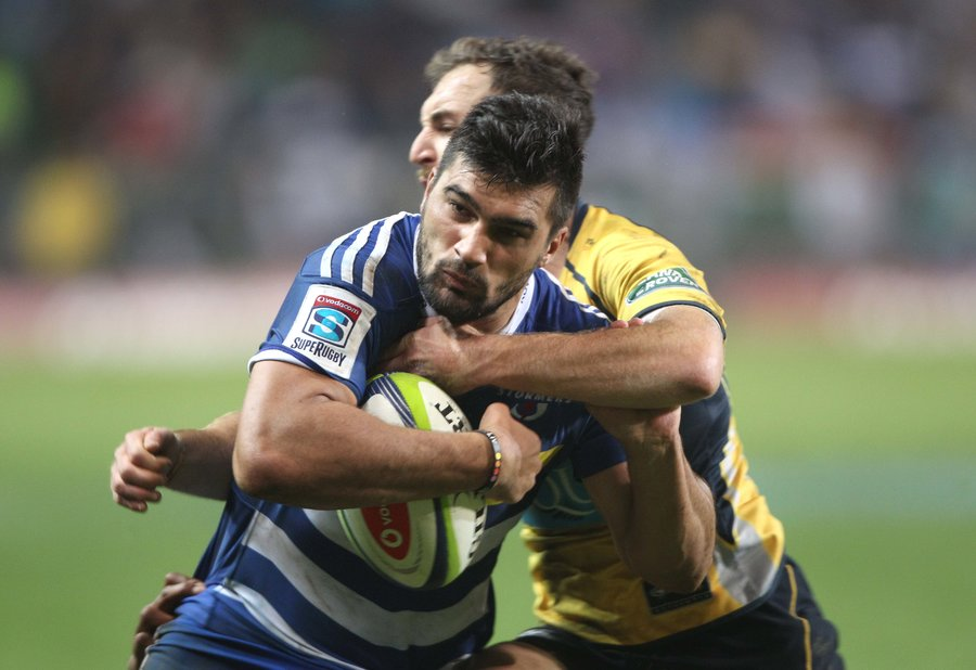 Damian de Allende of the Stormers takes on the Brumbies defence