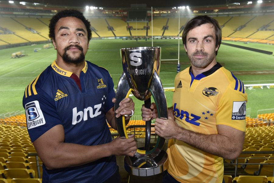Captain of the Hurricanes Conrad Smith (R) holds the Super 15 trophy with captain of the Highlanders Nasi Manu
