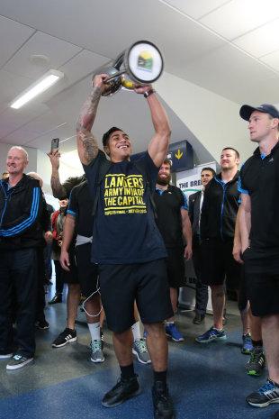 Malakai Fekitoa holds the Super Rugby trophy aloft upon arrival at Dunedin Airport, Dunedin, New Zealand, July 5, 2015