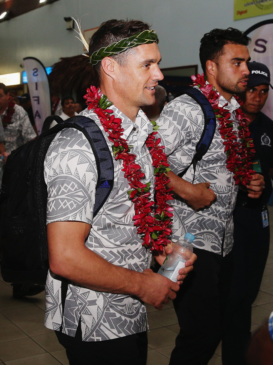 New Zealand's Daniel Carter and Liam Messam are welcomed at Faleolo Airport
