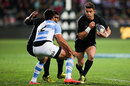 New Zealand's Dan Carter takes on the Pumas' defence
