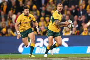 Australia's Quade Cooper attacks the line, Australia v South Africa, Brisbane, Australia, July 18, 2015