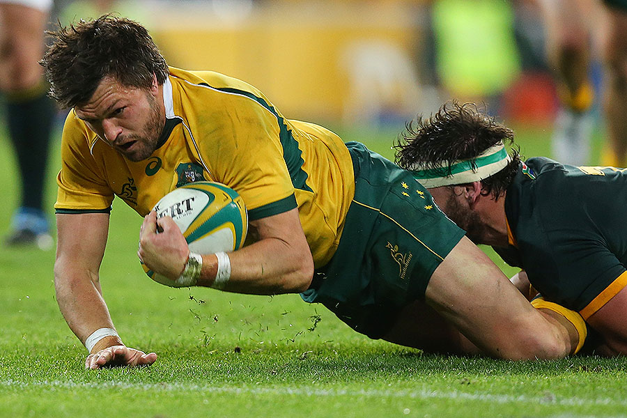 Australia's Adam Ashley-Cooper bounces over for a try
