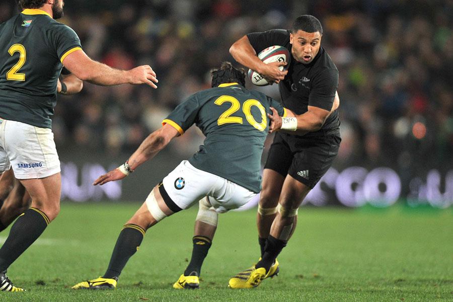 New Zealand's Lima Sopoaga takes he ball into contact