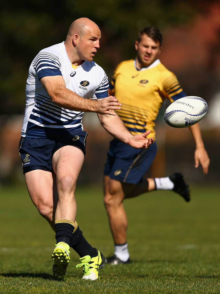 Australia's Stephen Moore passes the ball during a Wallabies training session