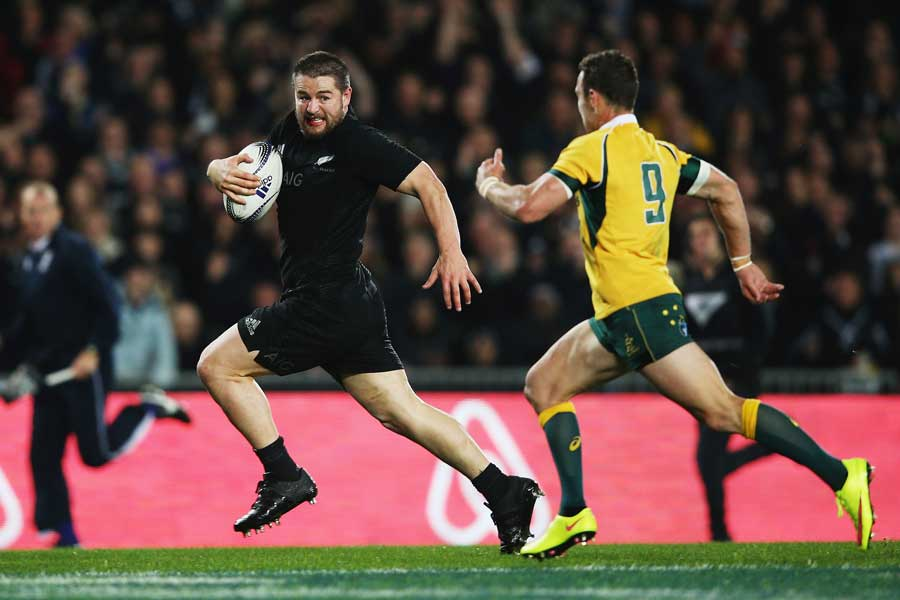 New Zealand's Dane Coles outsprints Nick White to score a try