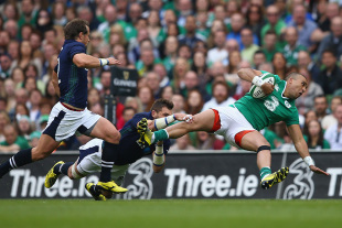 DUBLIN, IRELAND - AUGUST 15:  Simon Zebo of Ireland is tackled by Sean Lamont of Scotland during the International match between Ireland and Scotland at the Aviva Stadium on August 15, 2015 in Dublin, Ireland.  (Photo by Michael Steele/Getty Images)