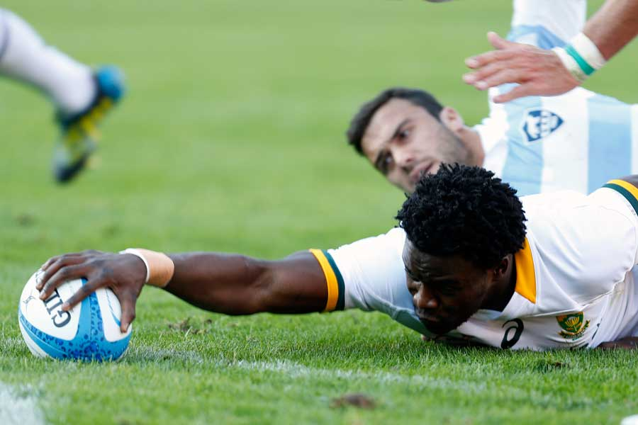 South Africa's Lwazi Mvovo reaches out to score a try