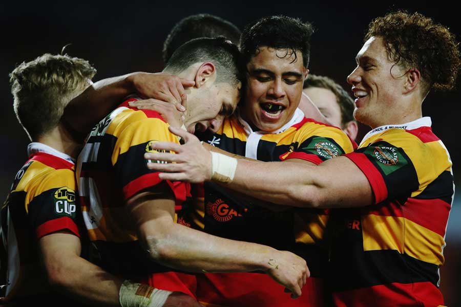 Waikato's Shaun Stevenson celebrates with Anton Lienert-Brown and Declan ODonnell after scoring a try