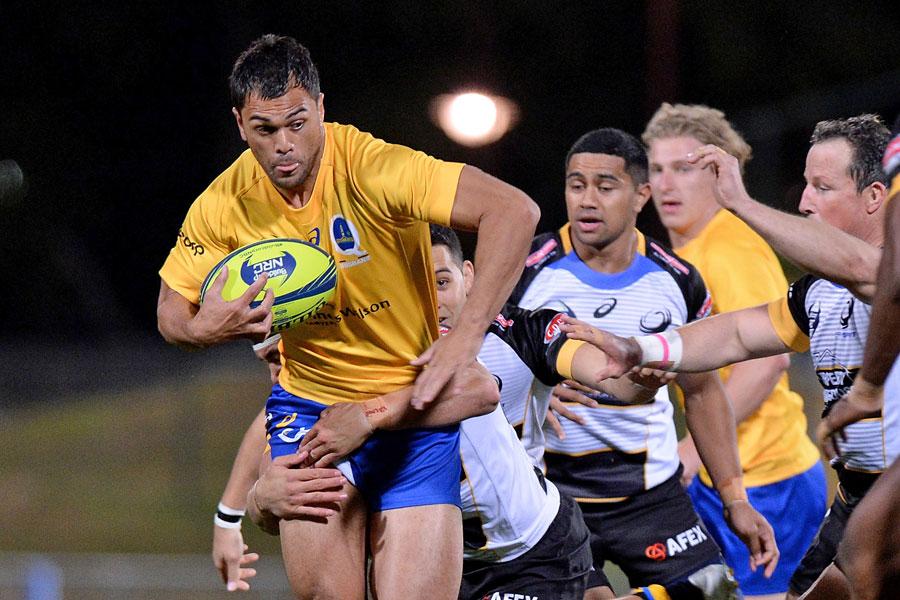 Brisbane City's Karmichael Hunt breaks the defence