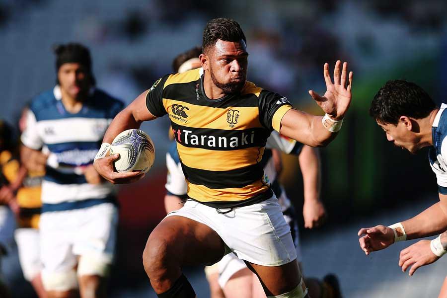 Taranaki's Seta Tamanivalu fends Ben Lam of Auckland