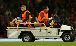 CARDIFF, WALES - SEPTEMBER 05:  Rhys Webb of Wales is stretchered off the field after suffering a leg injury during the International Match between Wales and Italy at Millennium Stadium on September 5, 2015 in Cardiff, Wales.  (Photo by Dan Mullan/Getty Images)