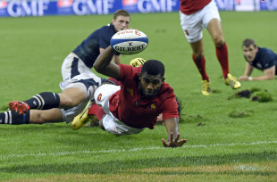 France's winger Noa Nakaitaci scores a try  during the rugby union test match between France and Scotland at the Stade de France in Saint-Denis, north of Paris, on August 5, 2015. AFP PHOTO / LOIC VENANCE