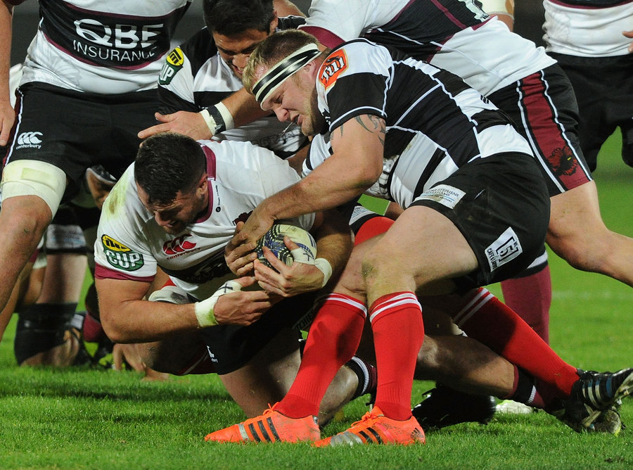 Alex Woonton of North Harbour and Mark Braidwood of Hawkes Bay tussle for the ball