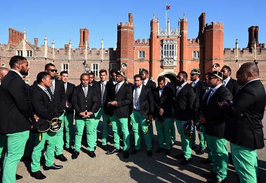 Members of the the Fiji 2015 World Cup Rugby Union squad sing outside Hampton Court Palace following their official welcoming Ceremony