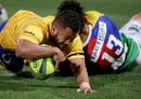 Brisbane City winger Mika Tela crashes over the whitewash
