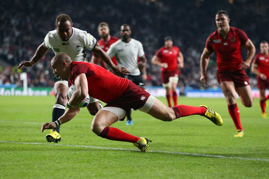 England's Mike Brown scores a try