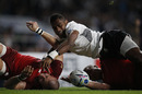 Fiji's scrum-half Nikola Matawalu (C) loses control of the ball and fails to score a try next to England's fullback Mike Brown (L) during a Pool A match of the 2015 Rugby World Cup between England and Fiji at Twickenham stadium in south west London on September 18, 2015.