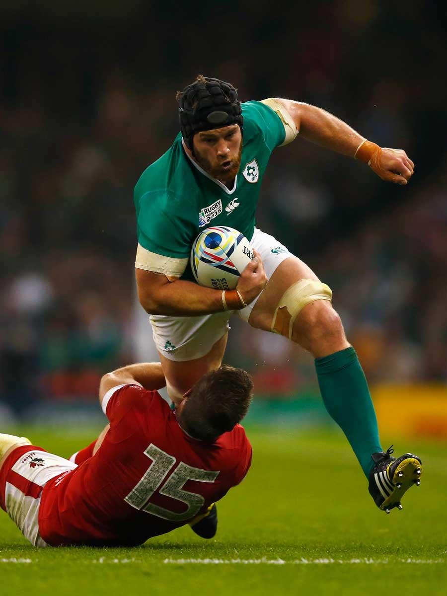 Ireland's Sean O'Brien breaks the tackle of Matt Evans