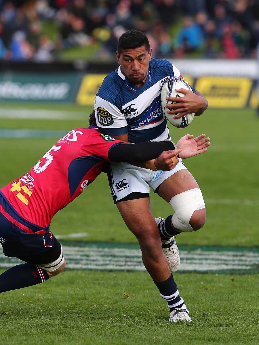 Auckland's Charles Piutau takes a tackle