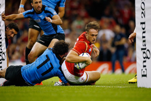 Cory Allen of Wales goes over to score his teams second try during the 2015 Rugby World Cup Pool A match between Wales and Uruguay at the Millennium Stadium on September 20, 2015 in Cardiff, United Kingdom.  (Photo by Stu Forster/Getty Images)