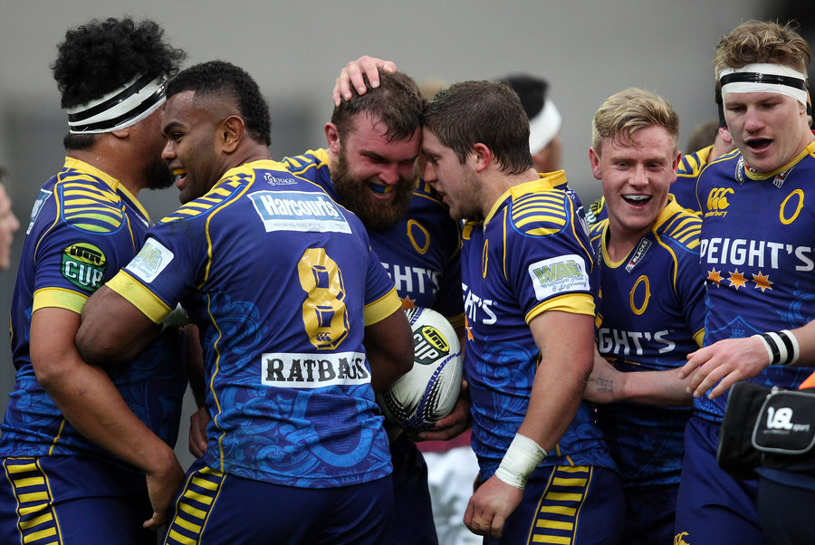 Liam Coltman of Otago celebrates his try with team-mates