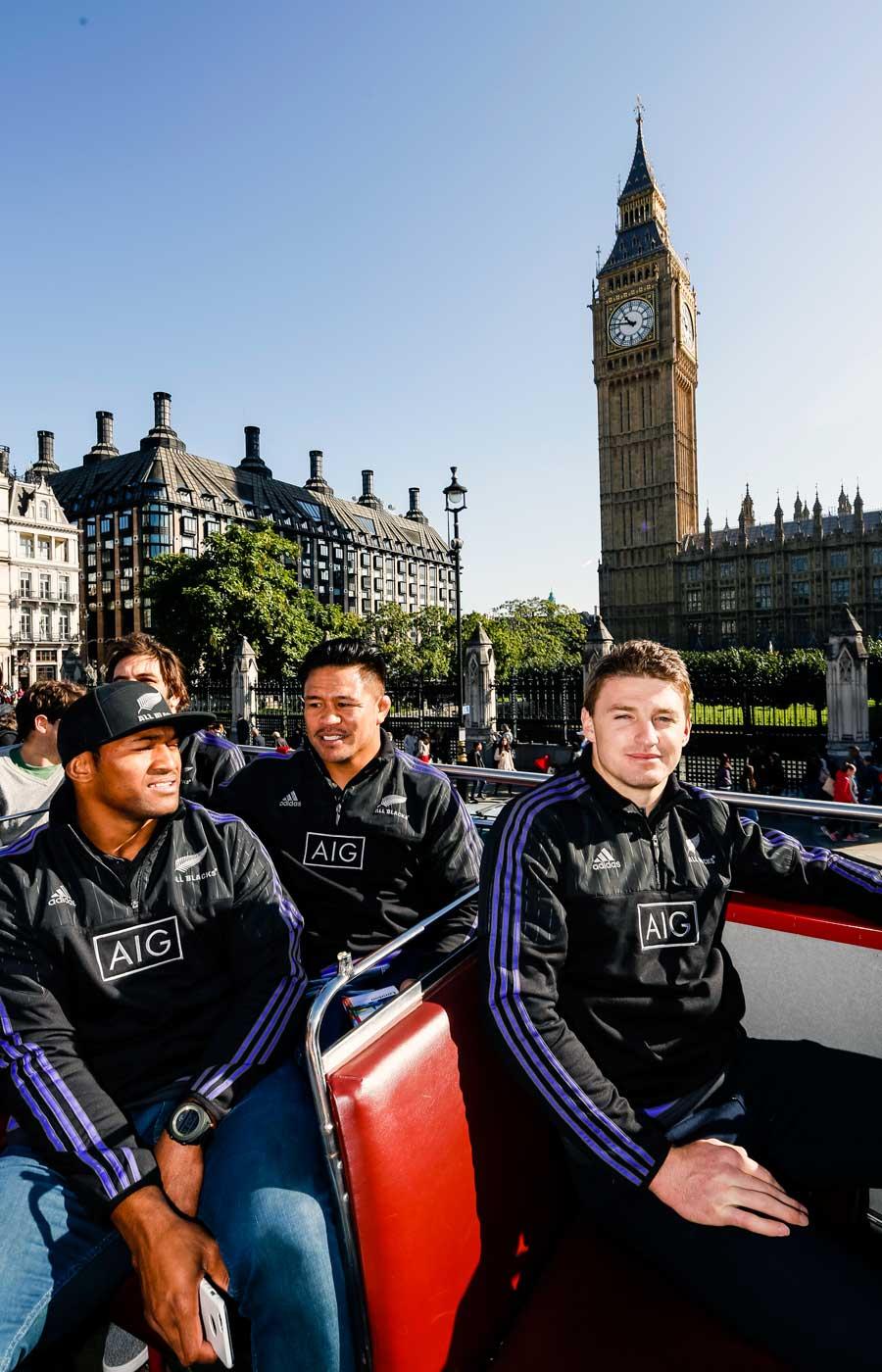 New Zealand's Waisake Naholo, Keven Mealamu and Beauden Barrett enjoy an open-top bus tour with sponsor AIG,