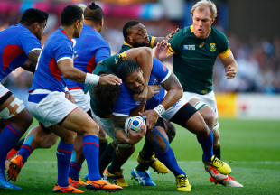 BIRMINGHAM, ENGLAND - SEPTEMBER 26: Alesana Tuilagi of Samoa is held up by the South Africa defence during the 2015 Rugby World Cup Pool B match between South Africa and Samoa at Villa Park on September 26, 2015 in Birmingham, United Kingdom.  (Photo by Laurence Griffiths/Getty Images)