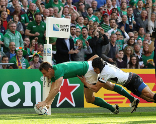 LONDON, ENGLAND - SEPTEMBER 27: Tommy Bowe of Ireland scores a try during the 2015 Rugby World Cup Pool D match between Ireland and Romania at Wembley Stadium, on September 27, 2015 in London, United Kingdom. (Photo by Mitchell Gunn/Getty Images)