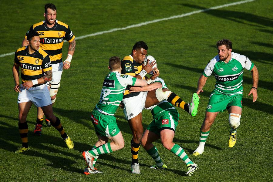 Seta Tamanivalu of Taranaki is tackled by Hamish Northcott of Manawatu