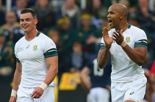 NEWCASTLE UPON TYNE, ENGLAND - OCTOBER 03:  JP Pietersen of South Africa (R) celebrates scoring a try with Fourie Du Preez of South Africa  during the 2015 Rugby World Cup Pool B match between South Africa and Scotland at St James' Park on October 3, 2015 in Newcastle upon Tyne, United Kingdom.  (Photo by Alex Livesey/Getty Images)