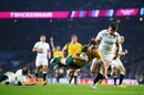 Australia's Bernard Foley dives over to score a try