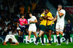 LONDON, ENGLAND - OCTOBER 03:  Chris Robshaw and Tom Wood (R) of England react as Bernard Foley of Australia celebrates scoring their first try with Tevita Kuridrani of Australia during the 2015 Rugby World Cup Pool A match between England and Australia at Twickenham Stadium on October 3, 2015 in London, United Kingdom.  (Photo by Mike Hewitt/Getty Images)