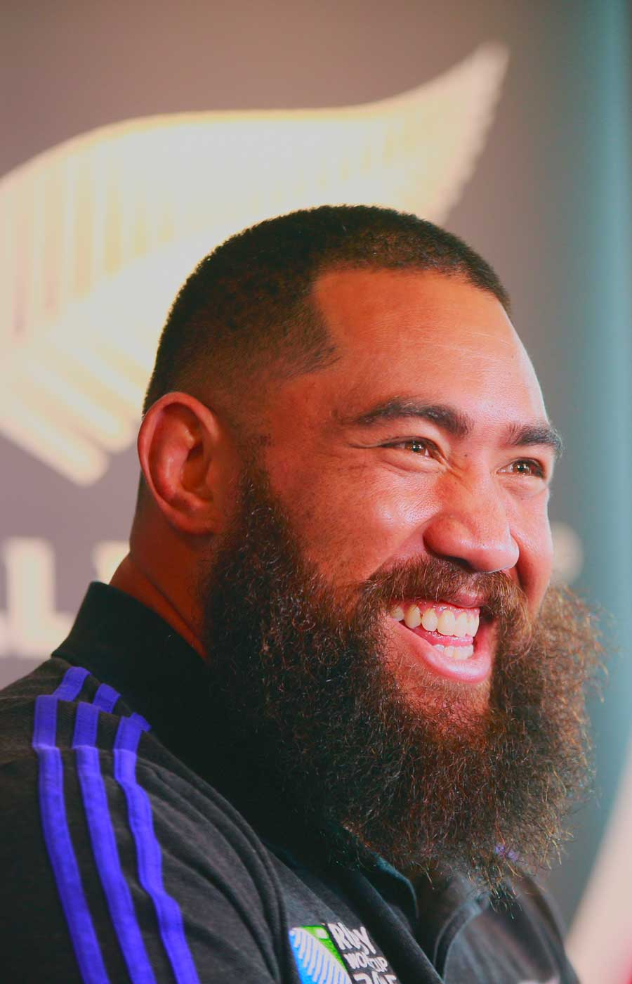 Charlie Faumuina laughs with the media