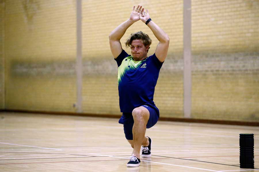 Michael Hooper stretches during an Australia team recovery session