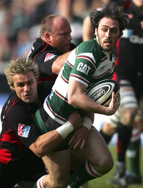 Julien Dupuy of Leicester Tigers is tackled by Justin Marshall of Saracens