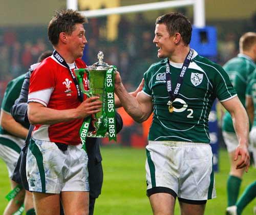 Ireland's Ronan O'Gara and Brian O'Driscoll celebrate their team's Grand Slam victory