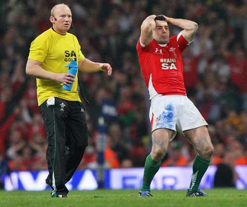 Wales' Stephen Jones looks on in disbelief as his penalty kick drops short