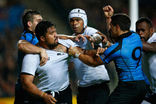 MILTON KEYNES, ENGLAND - OCTOBER 06:  Campese Ma'afu of Fiji (2L) and Agustin Ormaechea of Uruguay (9) clash after a try by  Kini Murimurivalu of Fiji during the 2015 Rugby World Cup Pool A match between Fiji and Uruguay at Stadium mk on October 6, 2015 in Milton Keynes, United Kingdom.  (Photo by Shaun Botterill/Getty Images)